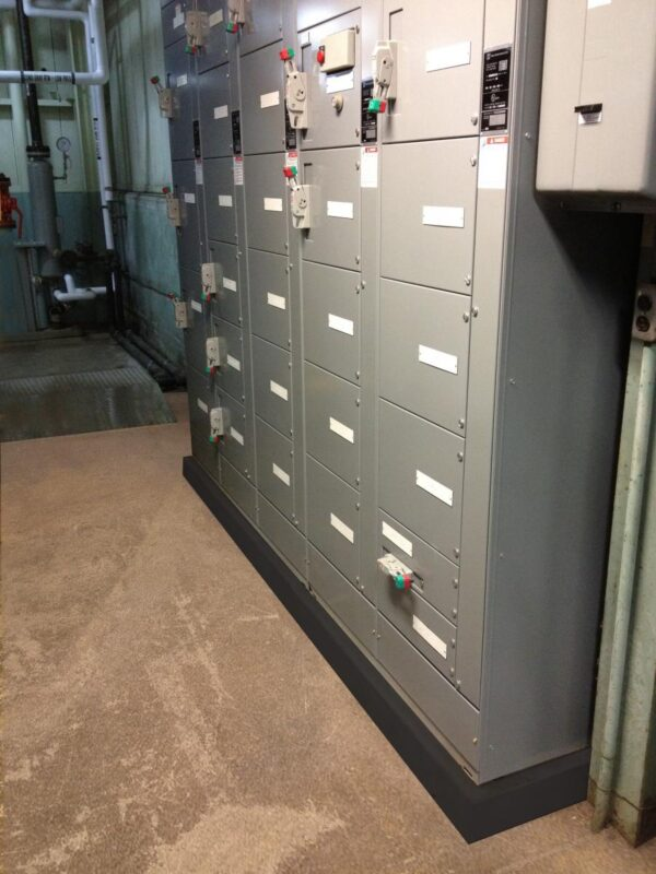 Electrical switch gear sitting on a polymer pre-cast housekeeping pad