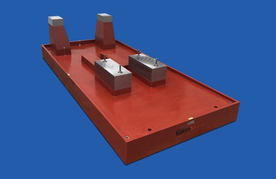 Pedestal mounted polymer pump base with embedded steel pads and sloped deck